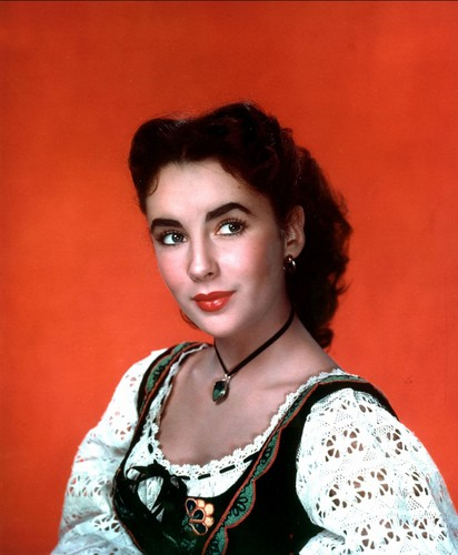 Elizabeth Taylor karatasi la kupamba ukuta probably containing a blouse, a pullover, and a chemise entitled Elizabeth Taylor