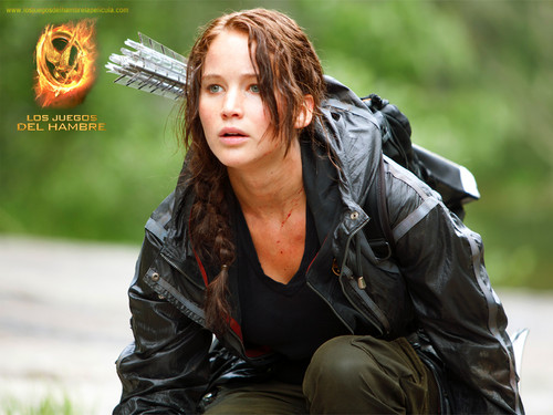 The Hunger Games wallpaper probably containing a box coat, an overgarment, and an outerwear called The Hunger Games