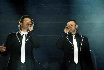 Justin Timberlake and JC Chasez Hintergrund with a business suit, a suit, and a well dressed person called Justin Timberlake and JC Chasez