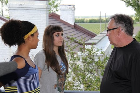 Michaela, Paris, and Dennis talking about the scene at Nottoway