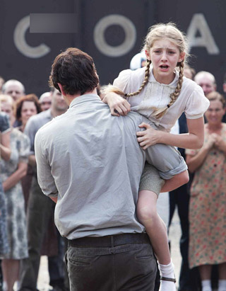 The Hunger Games wallpaper probably with a street titled Prim and Gale