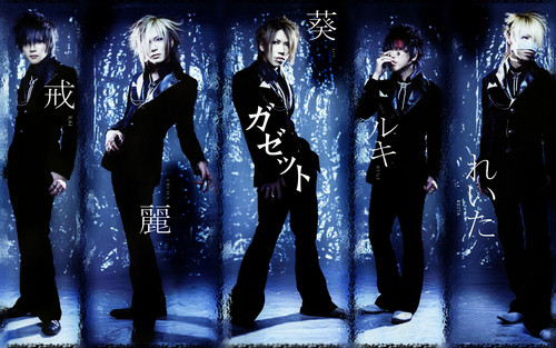 The Gazette achtergrond probably with a concert and a well dressed person titled The GazettE