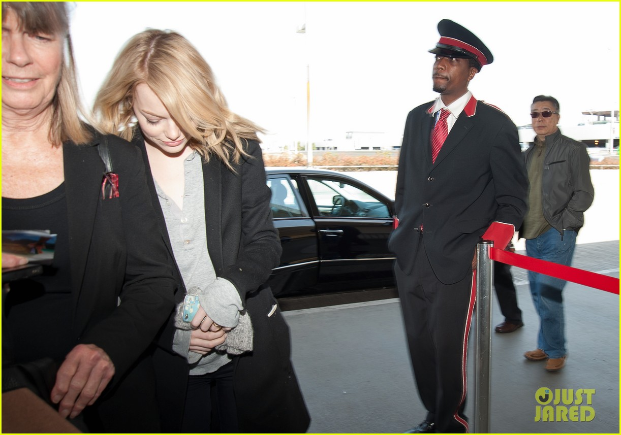 Emma Stone Heads Out With Her Head Down