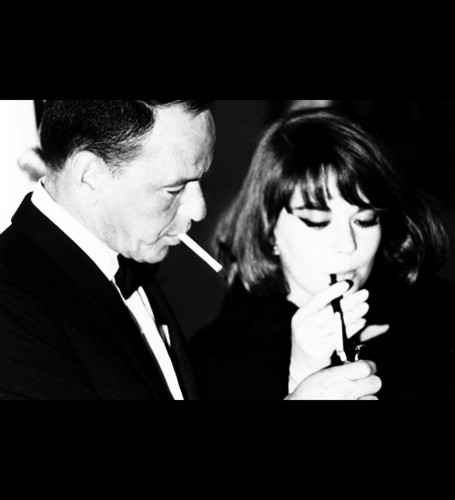 Frank Sinatra lights Nat's cigarette in 1964 at the premiere of 'My Fair Lady'
