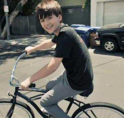 Greyson on Bicycle