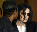 Jermain kissing Michael - michael-jackson photo