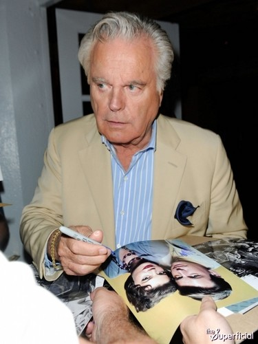RJ signing autograph with the picture of him and Nat in 2011