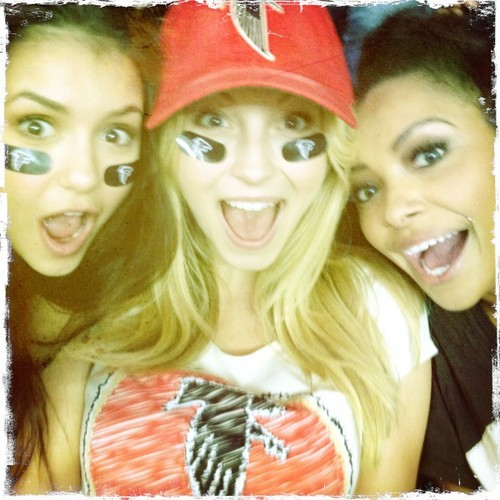 Nina Dobrev, Candice Accola & Katerina Graham wallpaper possibly with a portrait entitled The girls at a football game