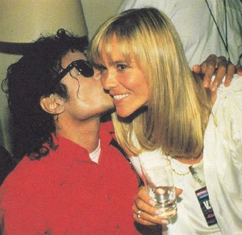 Michael Jackson wallpaper probably with a portrait called michael kissing christine decroix