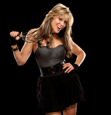 Lilian Garcia achtergrond probably with bare legs, a cocktail dress, and a hip boot titled Lilian