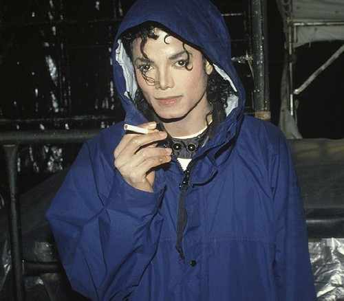 Michael Jackson wallpaper with a hood and a cloak titled Michael Jackson SMOKING?