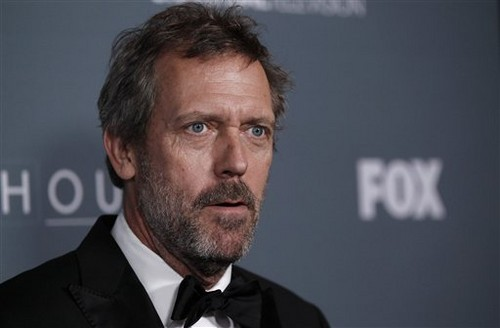 Hugh Laurie wallpaper containing a business suit called Hugh Laurie Wrap Party - April 20, 2012