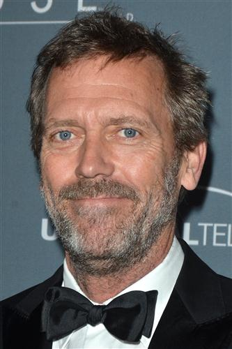 Hugh Laurie wallpaper with a business suit titled Hugh Laurie Wrap Party - April 20, 2012