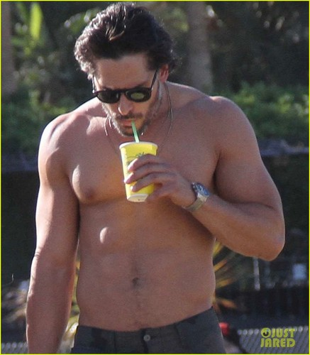 Joe Manganiello wallpaper possibly with a hunk, swimming trunks, and skin called Joe Manganiello: Shirtless at Coachella!