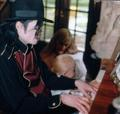 Michael playing the piano for Debbie, Paris and Prince. - michael-jackson photo