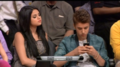 Selena and Justin at the Lakers game
