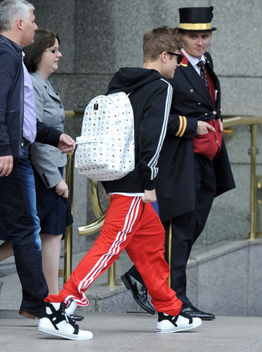 Justin Bieber leaving the Royal Garden Hotel in London