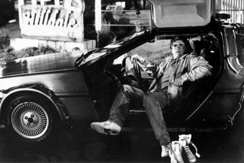 Robert Zemeckis sits in the Delorean
