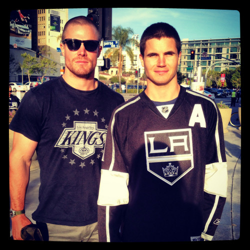 Stephen and Robbie Amell wallpaper probably with a sign, a jersey, and sunglasses entitled Amell brothers