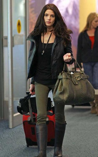 Ashley Greene wallpaper with a hip boot called Ashley Greene arriving in Vancouver for the 'Breaking Dawn' re-shoots (April 30).