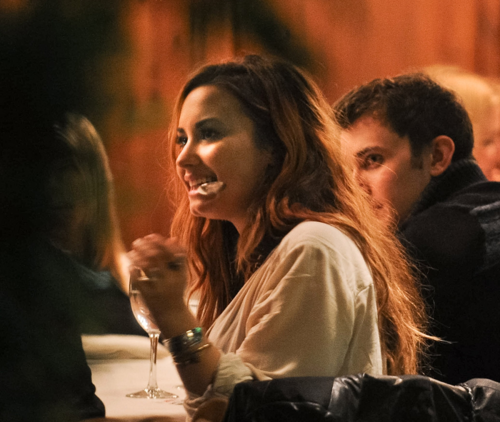 Demi - Having dinner with her band at a steakhouse in Buenos Aires, Argentina - April 27, 2012 - demi-lovato Photo