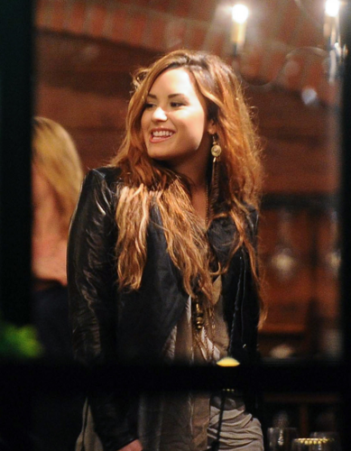 Demi Lovato images Demi - Having dinner with her band at a steakhouse in Buenos Aires, Argentina - April 27, 2012 wallpaper and background photos
