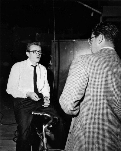 James Dean wallpaper probably containing a business suit, a sign, and a concert called James Dean