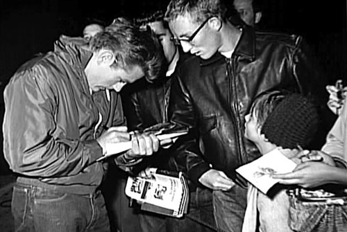 James signing the autographs