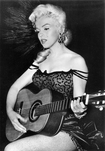 Marilyn Monroe wallpaper with an acoustic guitar called Marilyn Monroe (River of No Return)