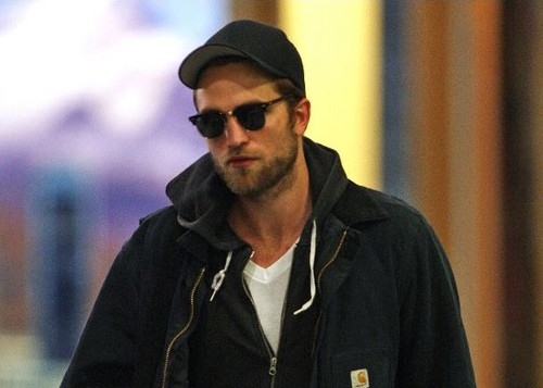 Robert Pattinson wallpaper probably containing an outerwear called Rob arriving in Vancouver, 29-04-2012