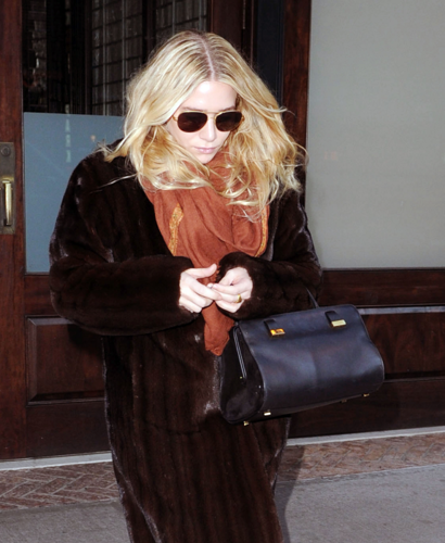 Mary-Kate & Ashley Olsen wallpaper containing sunglasses titled  Ashley - Leaving her hotel in New York, December 18, 2011