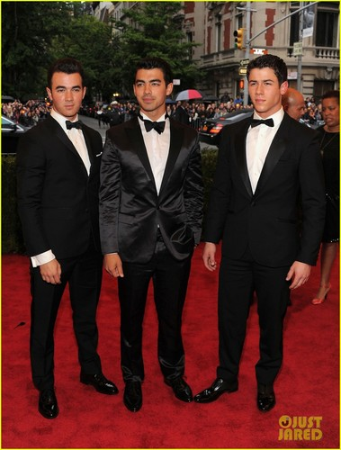 The Jonas Brothers wallpaper with a business suit titled 2012