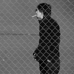 Three Days Grace kertas dinding with a chainlink fence titled Adam Gontier