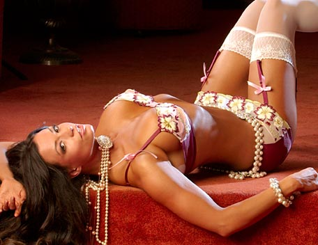 Candice Michelle wallpaper possibly containing a bikini called Candice Michelle Photoshoot Flashback