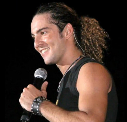 DAVID BISBAL PASSION GITANA wallpaper possibly with a dumbbell and a concert titled DAVID BISBAL