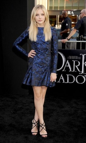 Chloe Moretz Hintergrund possibly with a cocktail dress and a hip boot titled Dark Shadows LA Premiere