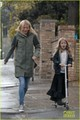 Gwyneth Paltrow &amp; Kids: Scooting in the Rain - gwyneth-paltrow photo
