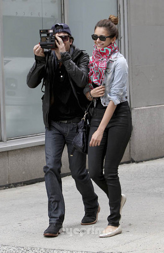 Ian Somerhalder and Nina Dobrev wallpaper probably with a street and a business suit titled Ian & Nina leaving the Trump Soho Hotel in New York (May 8, 2012)