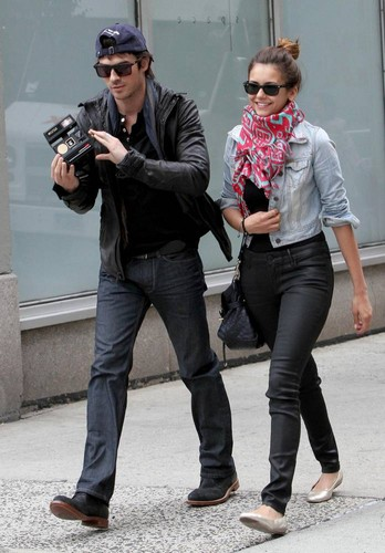 Ian Somerhalder and Nina Dobrev wallpaper probably with a business suit, a hip boot, and long trousers called Ian & Nina leaving the Trump Soho Hotel in New York (May 8, 2012)