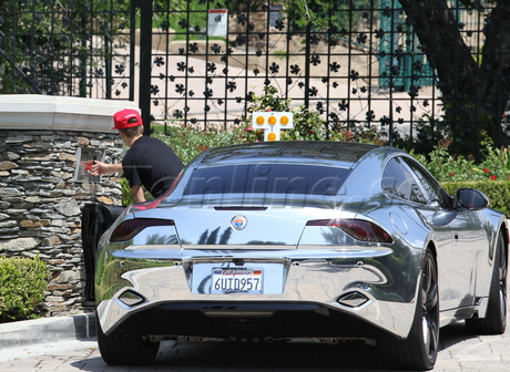 Justin Bieber driving in this Fisker Karma