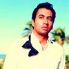 Kal Penn photo probably with a leisure wear, a sweatshirt, and a workwear called Kal
