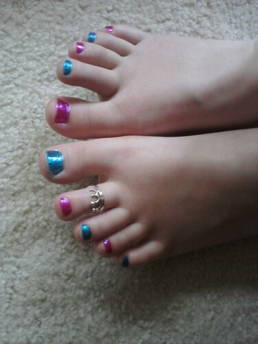 My mom painted my toenails my Favorit colors!!