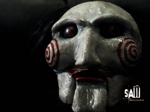 Filem Seram kertas dinding titled Saw...I want to play a game!
