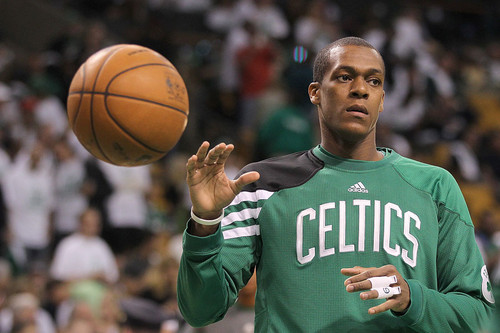 Rajon Rondo wallpaper probably containing a basketball, a dribbler, and a basketball player entitled game 3 win in overtime