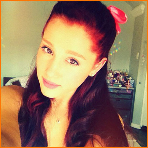 Ariana with a bow