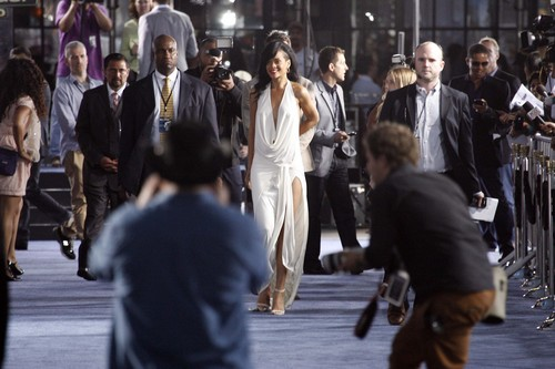 Rihanna wallpaper containing a business suit and a street called Battleship Premiere In Los Angeles [10 May 2012]