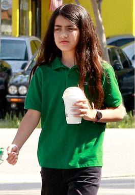 Paris Jackson kertas dinding probably containing a street, a leisure wear, and a hip boot called Blanket Jackson at Starbucks