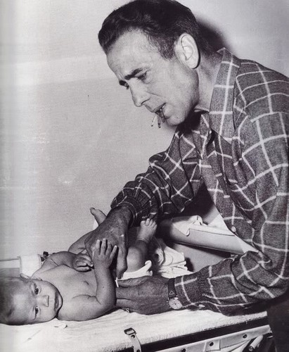 Bogart changing son Stephen's diaper