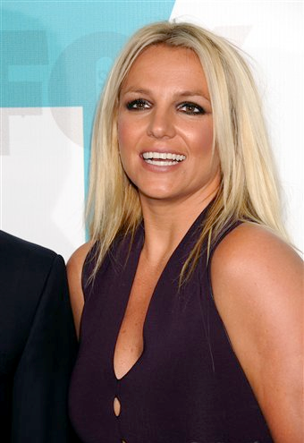 Britney Spears wallpaper with a portrait entitled Britney - X Factor Fox Upfront afterparty at Wollman Rink in Central Park - May 14, 2012