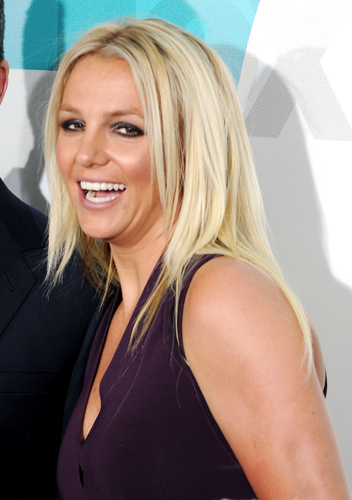 Britney Spears wallpaper probably containing a parasol and a portrait called Britney - X Factor Fox Upfront afterparty at Wollman Rink in Central Park - May 14, 2012